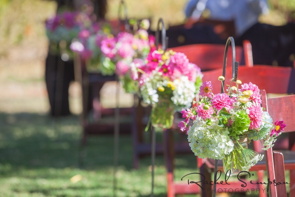 Floral arrangements for the ceremony that were later placed on dinner tables