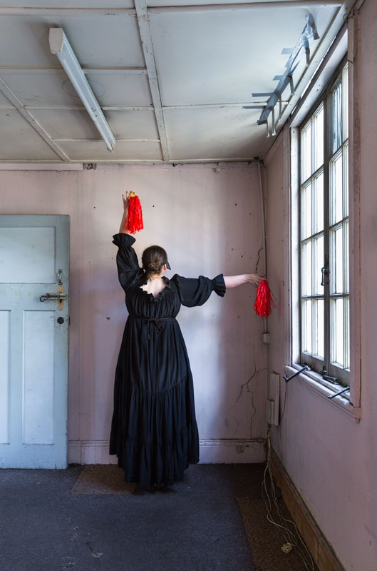 Girl with two tassels (red)