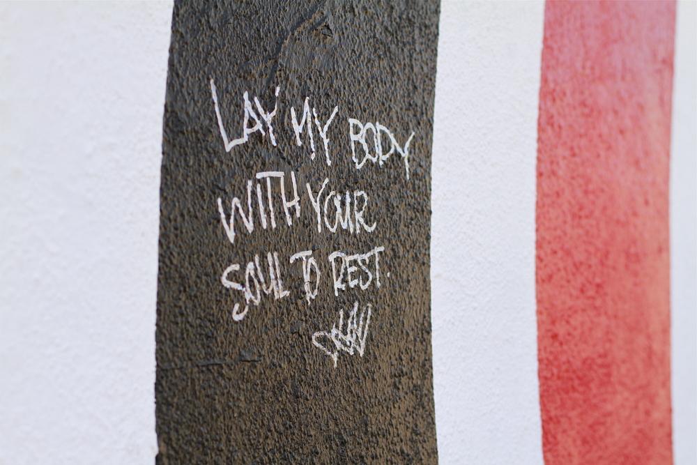 A fan leaves a message on the Elliott Smith tribute wall in Los Angeles.