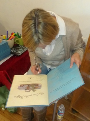 Jackie signs books at the launch