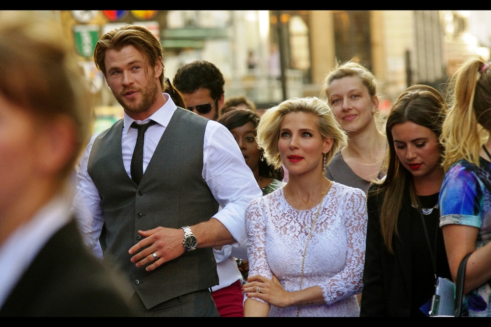 It's Chris Hemsworth! He plays Thor in the OTHER Marvel franchise about a team-up of heroes. Appropriately, I've photographed him at such premieres as  Thor ,  Thor The Dark World ,  The Avengers  ... and also non-Marvel premieres like the James Hunt biopic  Rush  . His wife Elsa Pataki is also an actress - she had a sizeable role in Fast and the Furious 5.