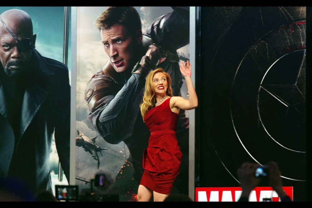 Scarlett Johansson plays Black Widow in the film, as she did in The Avengers and Iron Man 2, and the _'partially-lower-one's-middle-finger-to-wave-at-the-crowd'_ thing might be something that'll take off, or maybe it's more a Hollywood thing.