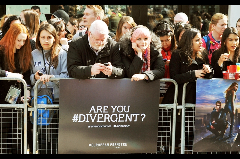 "Am I hashtagDivergent? No... I'm deeply cynical about a post-war, post-apocalyptic society that chooses to divide its people into unique, easily-merchandisable logotypes whereby it's totally freaking obvious which group the heroes/rebels come from. That was the stregth of Hunger Games - Katniss wasn't from the _""hey you're special district""_ - she was the hero who rose to combat society's injustice because she DID, not because some facebook profile threw out 'hashtag divergent' to help advertisers sell stuff to her based on her likes and dislikes on social media. And tell the government to keep an eye on her."