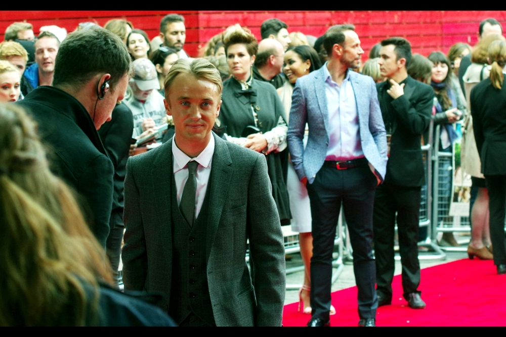 It's Draco Malfoy, all grown up! Actor Tom Felton hit a major growth spurt by the time of the second or third Harry Potter film and started dangerously towering over Potter. (Slytherin House Green Edit courtesy of Photoshop). I think I last photographed him at the  BFI Awards  a few years back.... alternatively I photographed him hugging Dumbledore at the final  Harry Potter at the Deathly Hallows Part2 premiere .