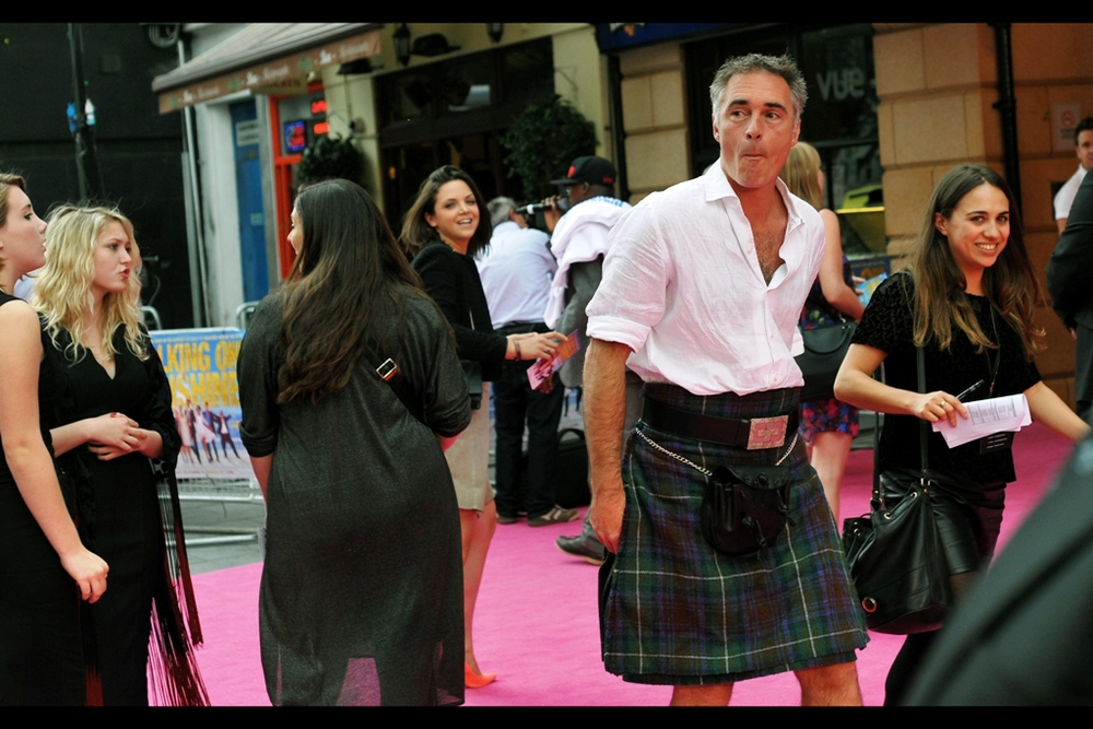 Greg Wise, along with wearing kilts to premieres (refer evidence), has also been in Sense & Sensibility (1995), several episodes of Homefront, and Johnny English (2003). Sense & Sensibility, incidentally, also starred the lovely Emma Thompson, who by sheer coincidence ....