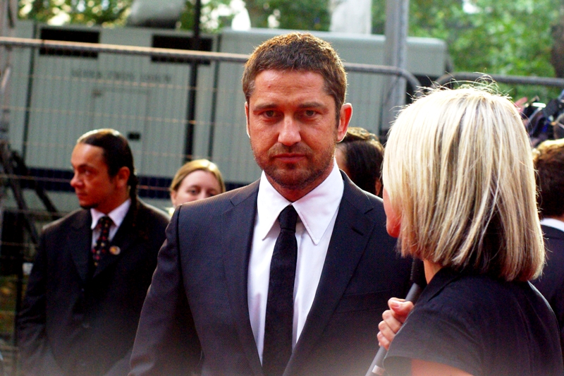 Gerard Butler. Who owes me $5 but is trying hard to pretend like he doesn't remember.