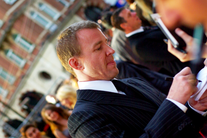 Guy Ritchie signing autographs (I like to think his name is pronounced 'Gi' in France)