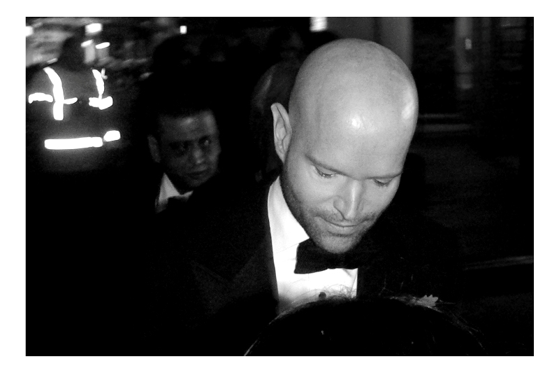 "People were saying ""He's the bad guy"" but I found it hard to tell whether people were talking about him or the character he may play in the movie. Still, if somebody gives you a piece of paper at a premiere, you're entitled to sign it. (Edited to add : People were wrong : he's Marc Forster - the director of the film) (then again... with the benefit of hindsight, with this movie widely criticised for being a sub-par Bond film, People Might Not Have Been So Wrong)"