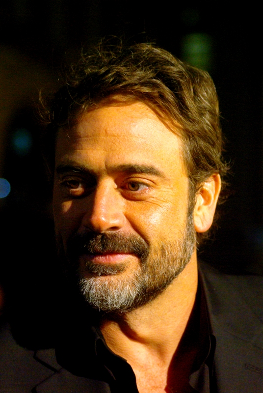 This is Jeffrey Dean Morgan, who looks vaguely familiar somehow. He plays the part of 'Dude with small eye-mask who smokes cigars' in the film. ('The Comedian', per IMDB). Alternatively, Robert Downey Jnr is taking his next role really seriously and is method acting.... as another actor entirely. Damn, that guy is commited to his job.