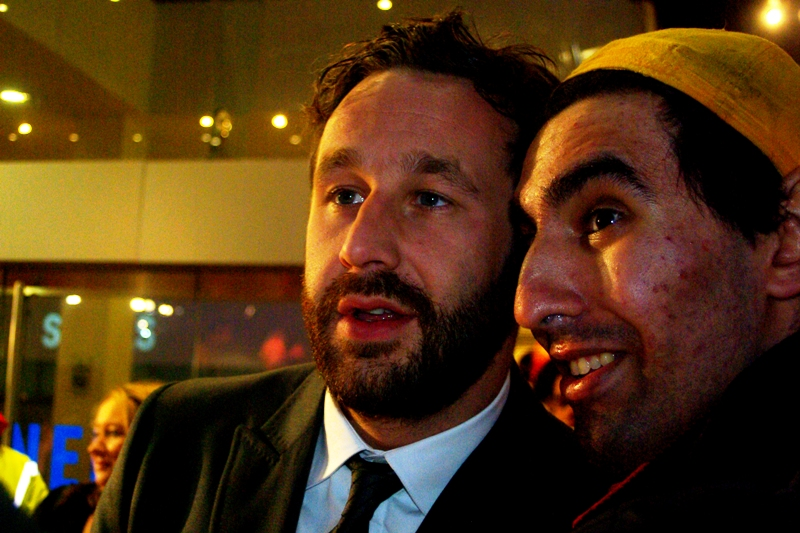 Actor Chris O'Dowd looks unsure in the presence of Yellow Cap Guy. Don't we all?