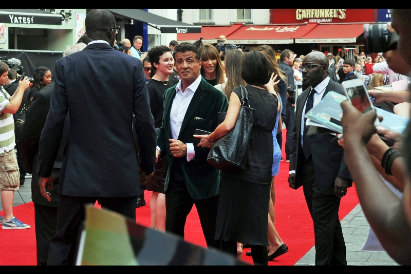 "Sylvester Stallone walks the red carpet with the comfortable and well-earned swagger of a man for whom there are announced or rumoured sequels to all three of his biggest franchises (""Creed"" for Rocky, ""Expendables 4"", and a possible fifth Rambo film).. On the other hand, the jacket might simply have been ironed/dry-cleaned a bit excessively."
