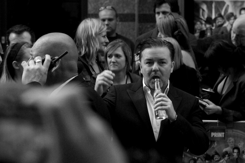 Ricky Gervais. Surprisingly likely to break into song at random moments, microphone in hand or not..