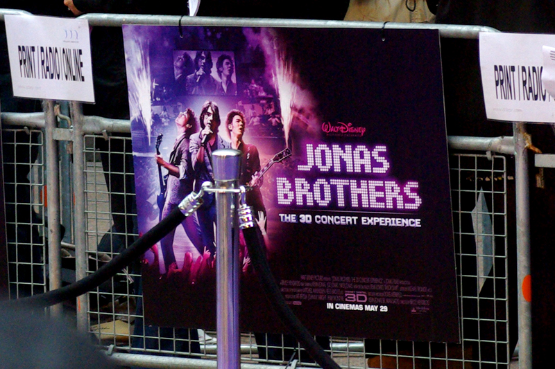 The Jonas Brothers. They're so big even their posters need to be roped off by security. (The deal with the Jonas Brothers appears to be that each is separately about 1/3 of a Zac Efron, but in combination might almost be as 'powerful' though the target market appears to be slightly younger. And I swear I was there mostly in case Taylor Swift showed up..)