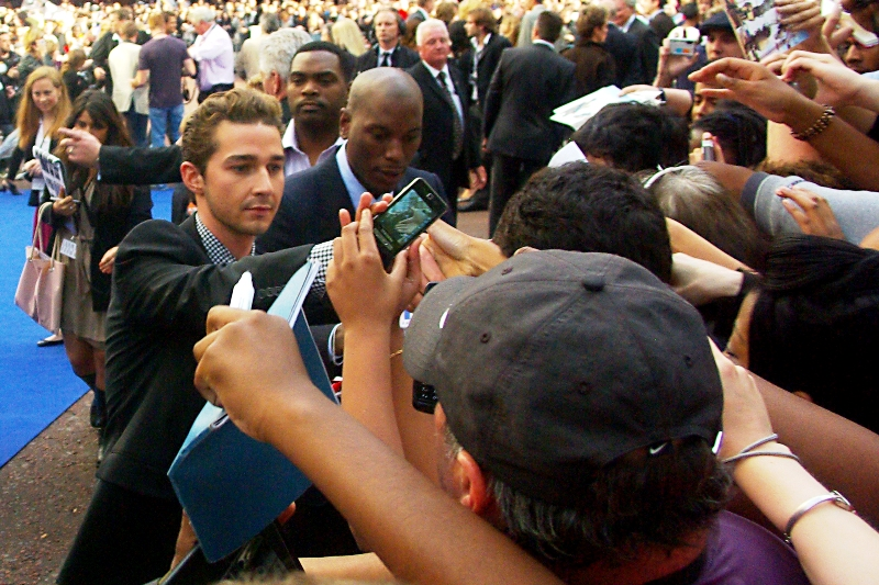 "Shia LaBeouf has arrived and is signing autographs so efficiently he's overtaking Tyreese Gibson. It's possible that Shia's signing ""Shia"" or even ""SLB"" or maybe just a lazy sprawling ""S"", while Tyreese is signing his full name Tyreese Darnell Gibson, with associated titles, honorifics and personalised greetings."
