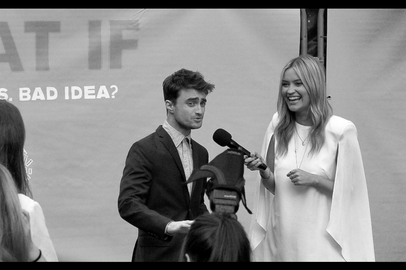 Daniel Radcliffe gets interviewed on the main stage (a small clearance to the side of one of the fan pens surrounded by VIP Paparazzi)... and answers the tough questions.