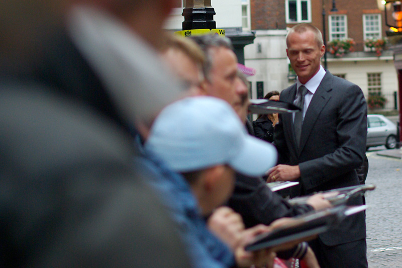 The face looked vaguely familiar - and my keen powers of observation noted people holding out DVD covers of the movies 'Wimbledon' and 'The Da Vinci Code' for him to sign. That (as well as people calling out 'PAUL' and there being a Paul mentioned in the movie poster) leads me to conclude this is Paul Bettany, the star of the film.