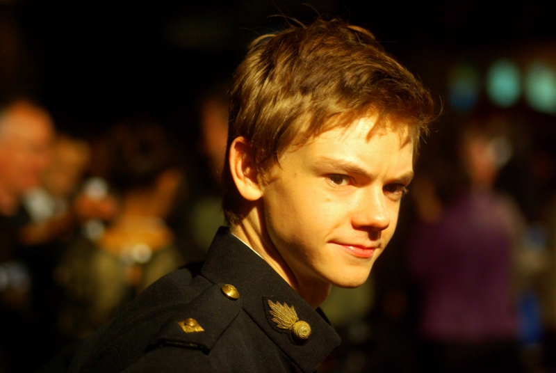 This is (I believe) Thomas Sangster. If so, he plays Paul McCartney in this movie. The pseudo-military jacket design may not be thematically accurate, but it is kind of cool.
