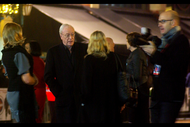 Sir Michael Caine alights from his vehicle, looking very Sir/Knight-like. Or… well… very Butler-like, given he's also Alfred the Butler in Batman. .. And a citizen vigilante in this film. (Approach him at your own risk, really!)