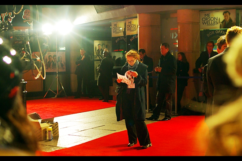Here's a lady checking out The List of expected attendees, and. I use the opportunity to check my status. Position in crowd fairly close to front? Check. Spare battery for camera? Check. Empty memory Card? Check. And finally…cripplingly bright light shining directly into camera? … yeah. That too.