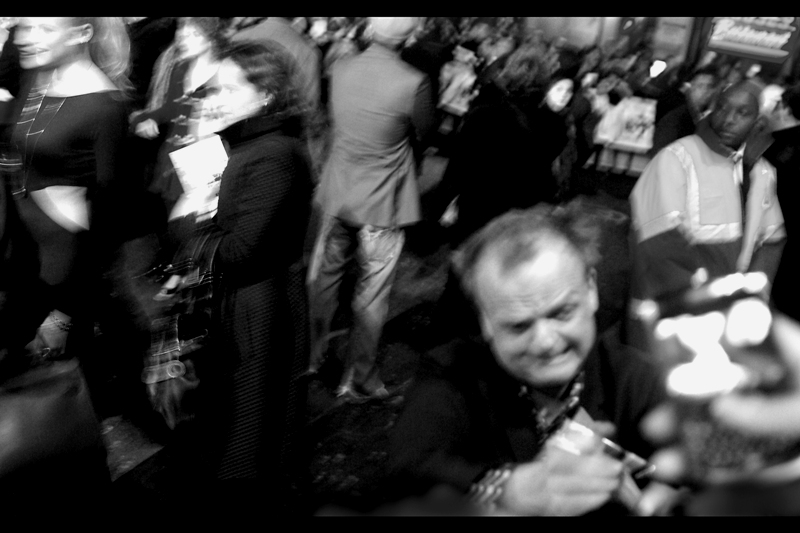 This may possibly be actor Toby Jones in the foreground and the crowd swirls around and I absently wonder whether I might have been better off using a flash for this photo. (He provides the voice of the character Dobby the House Elf in whichever Harry Potter films that character appeared. The second..?)
