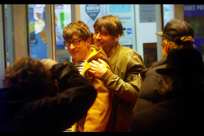 It's Graham Coxon and Alex James! (and yes, that means I finally relented and looked up a group shot on wireimage to find out who these people are!)