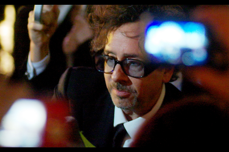 Tim Burton, shot around overlapping fans, their mobile phones, their point-and-shoots, their umbrellas, their autograph books and the rain. (They don't give out medals or knighthoods for civilian premiere photography, sadly.)