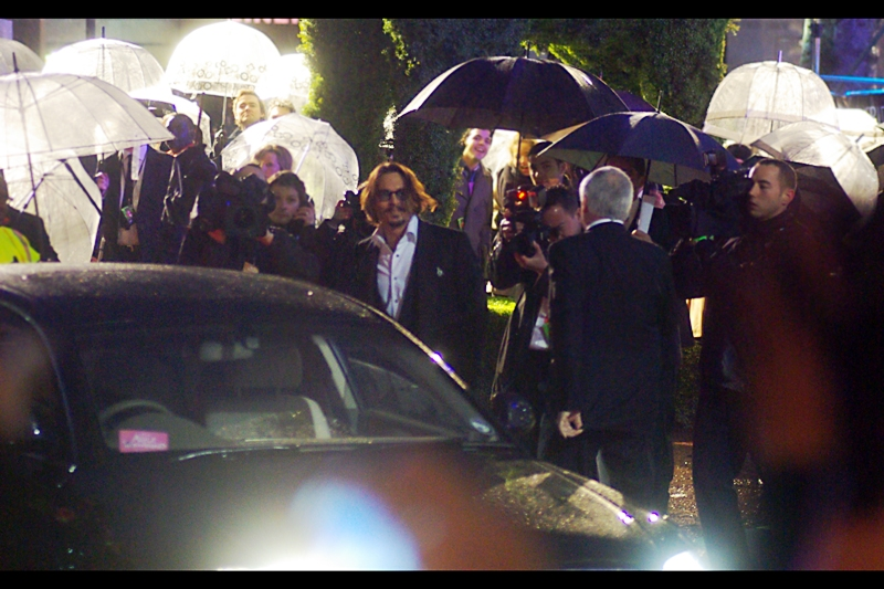 "And this is the other shot, after which Depp waved, bowed, then walked off to be  *awesome*  elsewhere. (He's Johnny Depp. What can  I  do?)  But feel free to console yourself with a couple of  Johnny Depp photos taken last year's premiere of ""Public Enemies"""