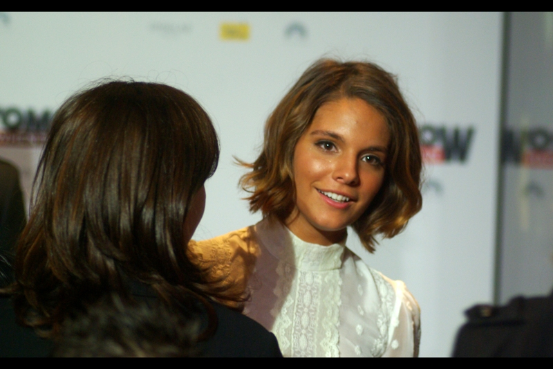 This is actress Caitlin Stasey. She's in the film, and has previously been in five episodes of 'Neighbours' and played 'herself' in the 49th annual Logie Awards. (Is that even a legitimate screen credit??)