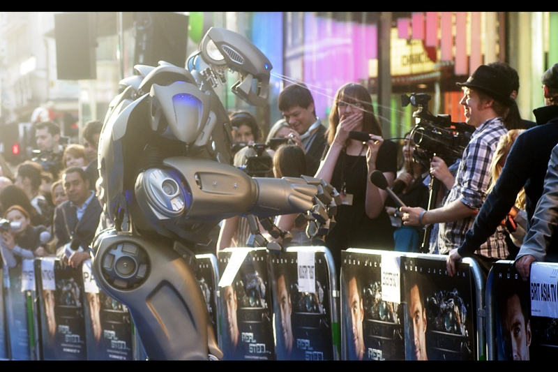 "Robot : ""I know now why you cry"" Reporter : ""Is that water?"" Robot :""No, it's lighter fluid. Can I borrow a match?"". (In truth, this was a rather remarkable machine - walking up and down the blue carpet spouting movie quotes and theme songs - very entertaining. Also possibly not murderous )"