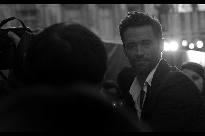Backlit Hugh Jackman looking awesome. (I'm calling it 'awesome' to hide the fact that my spot in the crowd was poorly chosen by me : it was facing INTO the sun. Rookie error) (By which I mean, I call it 'Art' and am backing this hole I'm digging myself into by uploading the shot....)