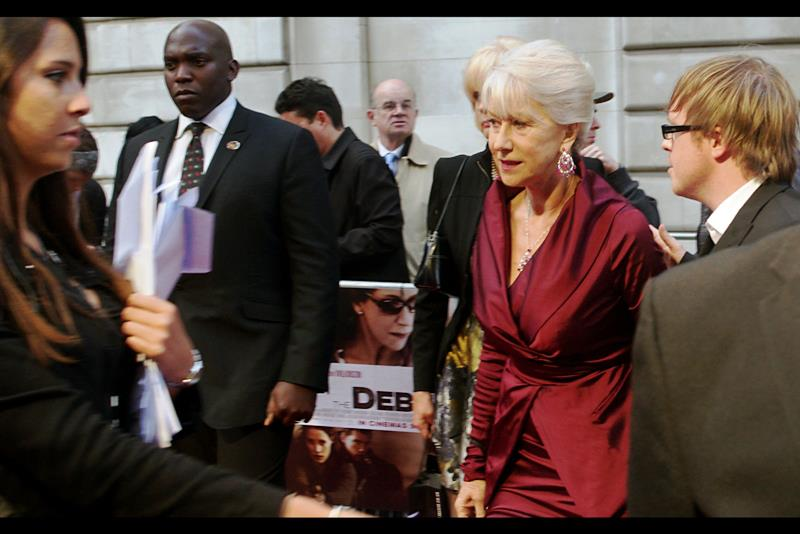 """The tattoo makes me cool? What about the Beretta in my handbag... does THAT make me cool, too?""  For legal reasons I'd like to clarify that I have no idea what Helen Mirren has in her handbag."