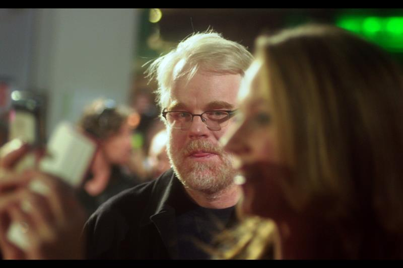 Philip Seymour Hoffman wants to know what on earth is more worthy of photographing at this precise moment than he is. (I'm with him - I haven't even SEEN Evan Rachel Wood at this premiere...)