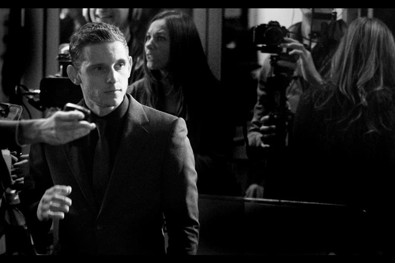 Jamie Bell, really really focussed on where he's walking next. Note for fans : he _does_ actually smile at times.