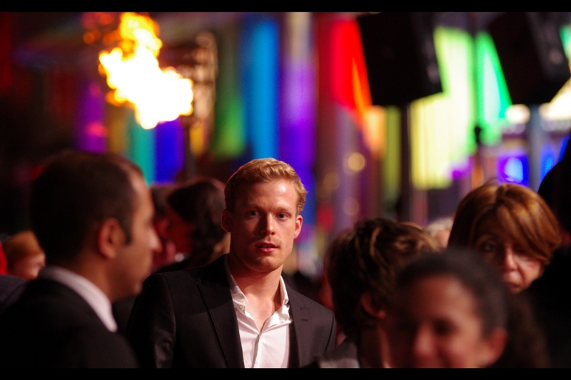 I'm so mesmerised by the lights and flames in the background that I almost miss Xavier Samuel and/or Sam Reid and/or Edward Hogg, any of whom this guy might be. In my defence, director Roland Emmerich cast a large number of young-ish, blonde-ish males in this film... and if you're not young and blonde and female there's every chance you'll slip beneath my notice. (Brunettes are fine, too, though)
