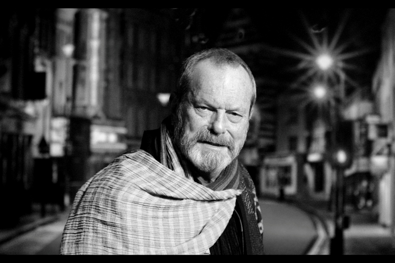 Director (albeit not of this film) Terry Gilliam shows up wearing what can only be described as a yellow-and-grey dishtowel as a cape. It's only to spare your retinas that I've converted the shot to black'n'white for you.