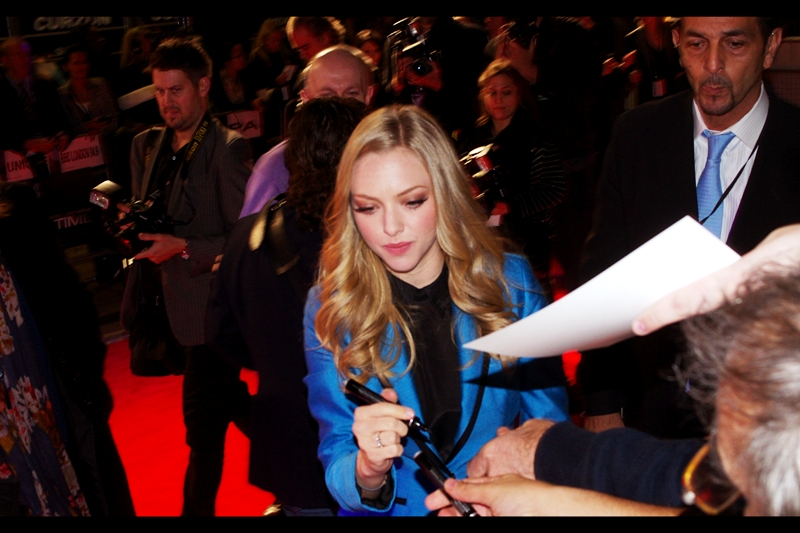"Amanda Seyfried was in ""Mean Girls"" and in  (and at the premiere for) 'Chloe'. .. and wears really really short shorts (not pictured) (yet) and thinks carefully before signing ANYTHING."