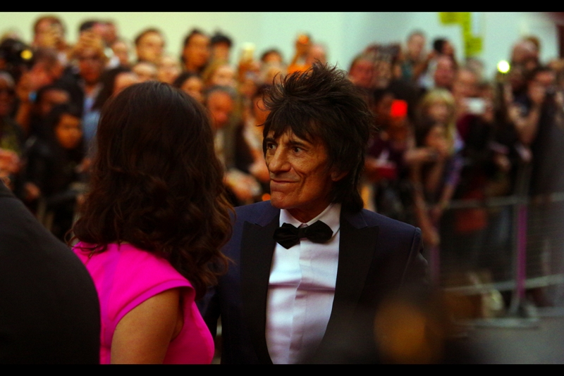 Ronnie Wood and a pink dress arrive. Roonie Wood is from the band The Rolling Stones, a group that holds the honour of causing more of my Not-For-Sale artworks taken down from Redbubble than any other artist or group. I own a couple of their albums.. but I assume actually playing them also constitutes some kind of copyright infringement so I generally don't.