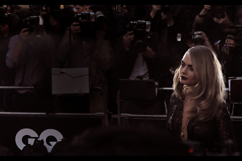 Model Cara Delevigne shows up and is certainly very pretty (or certainly knows how to pose VERY prettily). But there's one HUGE (ish) (sort of) name left to arrive... depending on your definition of 'huge', 'huge(ish)', 'name' and 'star' (or perhaps even 'arrive')