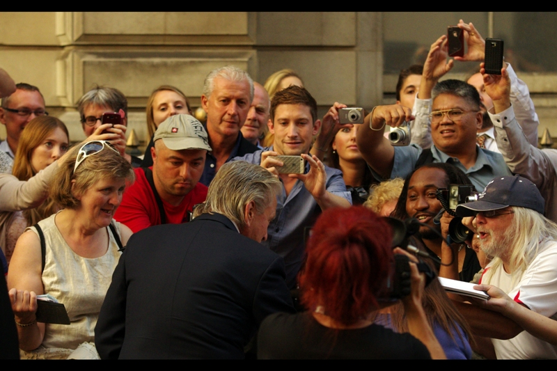 Michael Douglas signs autographs. Very cool. Also, he ended up winning the *Legend* award. I'm not a fan of the titles and categories GQ bestows (refer Emma Watson, below), but I'm not going to argue with Michael Douglas.