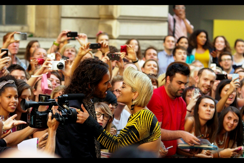 Rita Ora, singer, conveniently distracts Russell Brand for me!