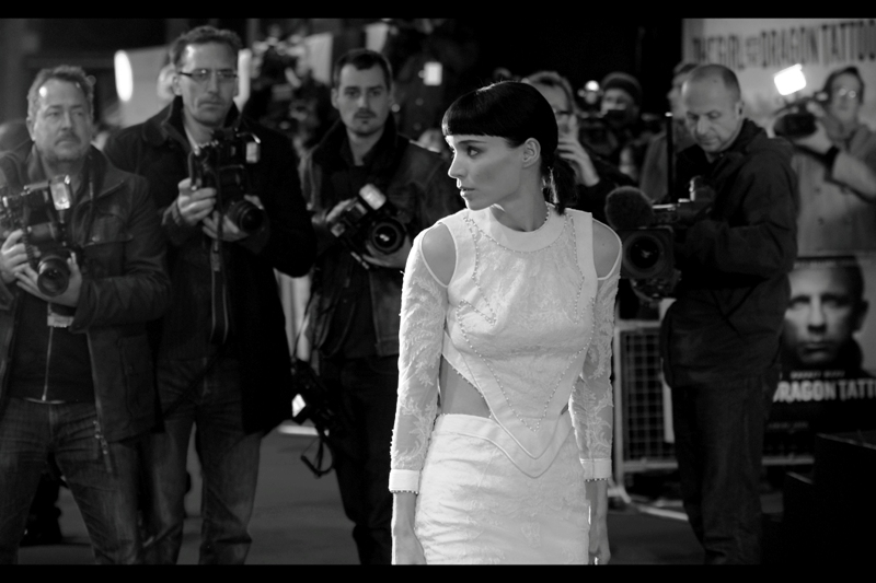 Actress Rooney Mara is first to emerge from the warmth of the cinema bar / cafe / pre-event drinks, and poses for the VIP Paparazzi. (The regular Paps were sent to the far back of the event, away from the women and chillun, with much protest, and we got the spot they'd been eyeing greedily. Winners!)