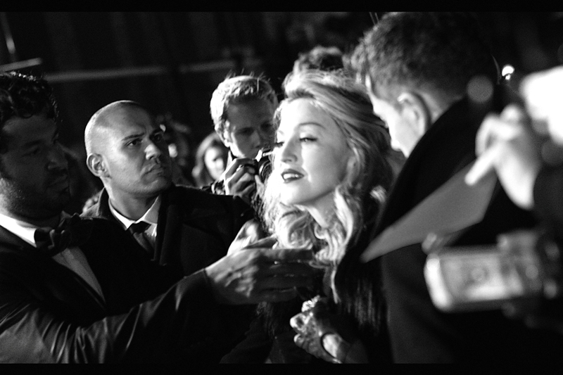 Madonna's handlers pursued a strategy of 'yo-yo-ing' her back and forth from the media area to the crowd to alternate between being interviewed and signing autographs. And then, sporadically, her hair would be brushed on the carpet. Intriguing