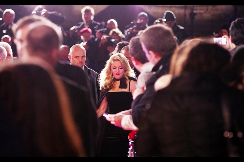 "Fave shot of the night was the long range one when she decided at the last moment to turn around from facing the paparazzi and sign a couple more autographs and the security goons didn't react fast enough to cover her fore and aft flanks (or something). I call this photo ""It's Madonna"" - because it is!"