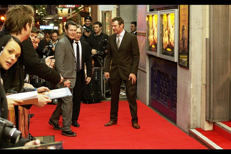"The guy on the left is Nick Moran, and I've had to do some searching to find out why people were getting him to sign Harry Potter merchandise... apparently he was a Snatcher called ""Scabior"" in the last two Harry Potter films.  (Poor Scabior... with that name, his parents never really gave him a chance..)."