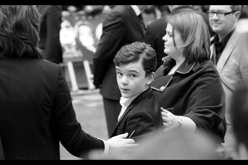 "I have no idea who this kid is. But he signed autographs. Those people may also not have known who this kid is. If, however, he's Gulliver McGrath then he IS in this film, he was also in  Martin Scorcese's ""Hugo"""