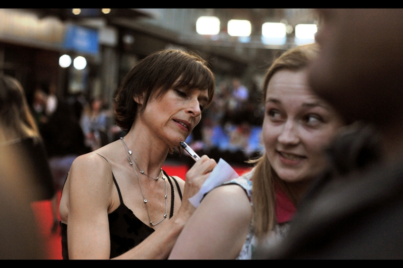 """That pen has a really sharp nib, but I'd still rather have a nice autograph rather than a quick scribble"" . Some girl is about to find out whether actress Amelia Bullmore has ever had a background in tattoo artistry. (Scrolling down Amelia Bullmore's filmography, I seriously count FIFTEEN recurring TV series roles before I finally got to one I'd actually heard of (and that ended in 1995!))."