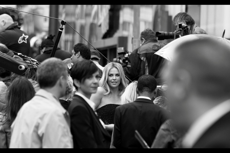 "Charlize Theron at  the world premiere of ""Prometheus"".  I'd never photographed director Ridley Scott, or gotten Charlize Theron's autographs> I walked away with a photo of both an an autograph from both. That's... kind of awesome, actually."