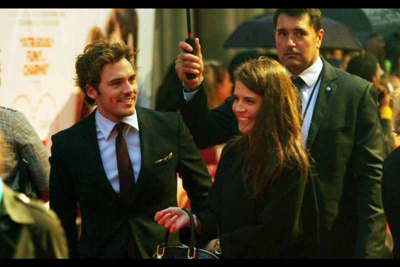 "Next to arrive is actor and leading man Sam Claflin, best known for being in and pulling fantastic faces at the premieres of ""The Hunger Games Catching Fire"", ""The Quiet Ones"" and ""Snow White and the Huntsman"""