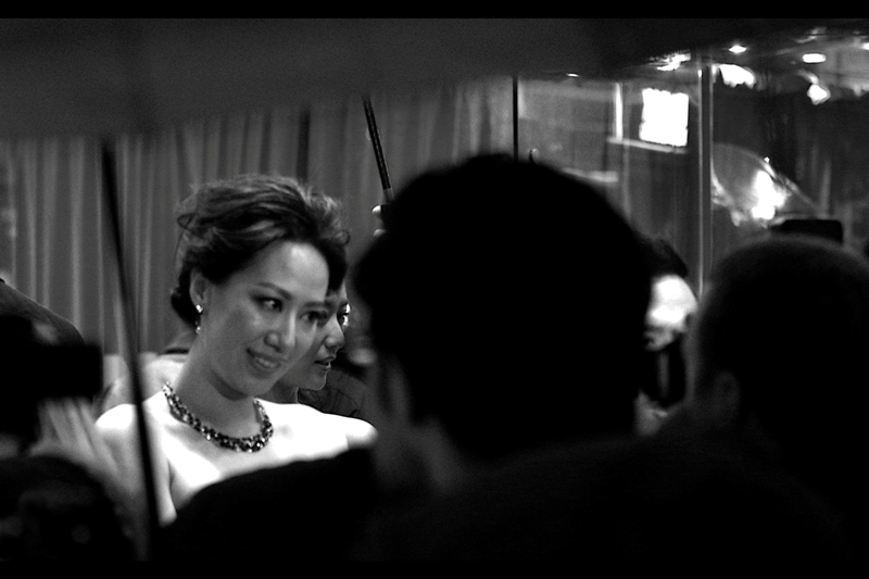 Cecilia Wang, imdb eventually informs me, is Donnie Yen's wife. I don't usually make it a habit to photograph 'civilians' at premieres, but I want to celebrate one of the more in-focus shots I managed during the half-hour.