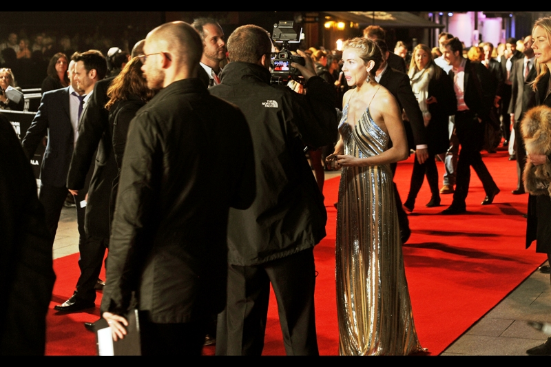 Still... on the Awesome side, the beautiful Sienna Miller has taken up a spot on the Red Carpet, facing in my direction, to be interviewed....